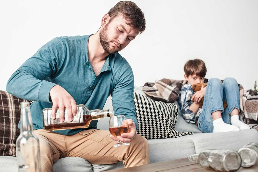 a child crying while his dad drinks not thinking about alcoholism and parenting