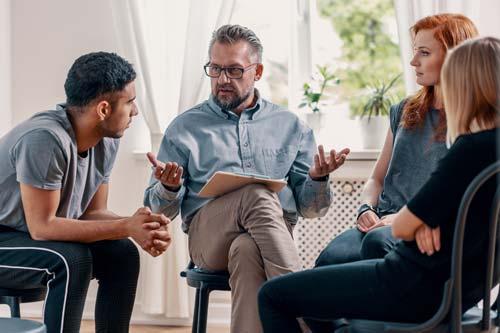 man explaining detox programs in louisiana to a group